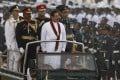 Sri Lanka's President Mahinda Rajapaksa (centre) inspects a military parade in Colombo. Photo: Reuters
