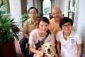 Lily Lam and labrador Bella with Hong Kong Guide Dogs Association staff (from left) Eddie Lee, Brian Francis and Fish Chan.