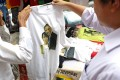 A T-shirt featuring the picture of US President Barack Obama and Myanmar opposition leader Aung San Suu Kyi at a shop in Yangon. Obama is expected at the upcoming East Asia Summit hosted by Myanmar. Photo: EPA