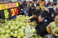Wal-Mart plans to spend 300 million yuan on food safety in China in the three years to 2015, up from 100 million yuan. Photo: Reuters