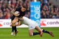 Joe Marler of England tackles New Zealand centre Sonny Bill Williams during their match on Saturday. Marler has urged his team-mates to take the frustration from the 24-21 defeat by the All Blacks into this weekend's second test against South Africa. Photos: AFP