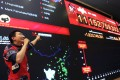 """An employee at Alibaba headquarters in Hangzhou draws attention to the rising Double 11 sales. """"Singles Day"""" is the mainland's busiest online shopping day. Photo: Xinhua"""
