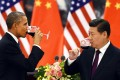 After two days of intense negotiations, Barack Obama and Xi Jinping share a toast at the Great Hall of the People in Beijing. They reached agreement on a host of issues including climate change. Photo: AFP