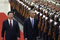Chinese President Xi Jinping (left) and US President Barack Obama review honour guards during a welcoming ceremony at the Great Hall of the People  in Beijing. Photo: EPA