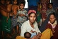 A Rohingya woman with her baby at a temporary shelter. Photo: AFP