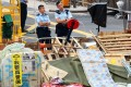 Police keep watch next to a barricade at the Mong Kok protest camp on Friday. Photo: Kyodo