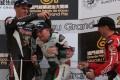 Martin Jessopp (left) and Michael Rutter shower Stuart Easton in champagne. Photo: KY Cheng