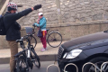A Beijing cyclist gestures at a car illegally using the designated bike lane. Photo: Weibo
