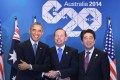 Barack Obama, Tony Abbott and Shinzo Abe seal a deal to strengthen military ties between their countries. Photo: AFP