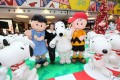 Sun Hung Kai's Maureen Fung with Snoopy and other stars of Peanuts at APM mall. Photo: SCMP Pictures