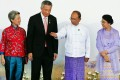 Singapore's Prime Minister Lee Hsien Loong (second left) and his wife Ho Ching (left) are welcomed by Myanmar's President Thein Sein (second right) and his wife Khin Khin Win before the opening ceremony of the 25th Association of Southeast Asian Nations (ASEAN) summit in Naypyitaw. Photo: Reuters