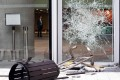 One of the glass doors at the Legislative Council complex that was smashed by masked intruders. Photo: Felix Wong