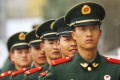 Officers in the People's Liberation Army who want career advancement must prove their loyalty to the Communist Party. Photo: EPA