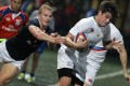 Hong Kong's Max Woodward gets to grips with Russia's German Davydov during the second Ustinov Cup test on November 15. Photo: Edward Wong/SCMP