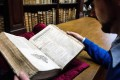 Librarian Remy Cordonnier with the First Folio he found while selecting books for an exhibition on English literature. Photo: AFP