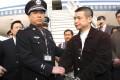 Yu Zhendong (right) voluntarily returned to China. Photo: AP