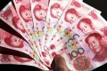 Swift reports that 15 more countries are now using yuan to settle over 10 per cent of their trade and investment deals with the mainland and Hong Kong. Photo: EPA