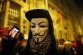 A protester holds his mobile phone during a protest against new tax on Internet data transfers in centre of Budapest. Photo: Reuters