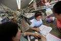 Bookshop owner Helen Duong helps schoolgirls with their homework at her store in Alhambra, California. Photo: TNS