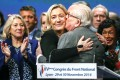 Marine Le Pen receives congratulations from her father, Jean-Marie Le Pen, after winning the National Front election. Photo: Reuters