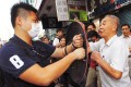 Protesters clash with each other in Mong Kok. Photo: Edward Wong