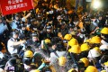 Police use pepper spray on pro-democracy protesters outside government headquarters in Tamar. Photo: Edward Wong