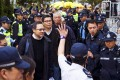The Occupy Central trio of Benny Tai, Dr Chan Kin-man and the Reverend Chu Yiu-ming walk to Central Police Station yesterday. Photo: Reuters