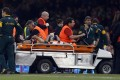 South Africa captain Jean de Villiers is stretchered off after shattering his left knee in the test against Wales at the Millennium Stadium last weekend. Photo: Reuters