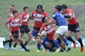 Male Sau of Japan fends off a South Korean defender during their Asian Five Nations clash in May this year. With the Top Five becoming a Top Three competition next year, these two teams and Hong Kong will meet more regularly. Photo: AFP