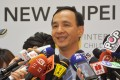 Eric Chu speaks to the press in Taipei on Wednesday. Chu will have to stake out his position on cross-strait issues if he runs for president in 2016, analysts say. Photo: CNA