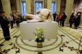 Visitors look at the sculpture of the Greek river god Ilissos at the State Hermitage Museum in St. Petersburg, Russia. The statue will be displayed until January 18. Photo: AFP
