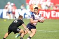 Daniel Hoyland of Scotland in action against New Zealand on the first day of the Dubai Sevens. Photo: Martin Seras Lima/World Rugby