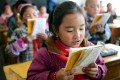 """China Daily said migrant """"workers' children who cannot attend urban schools are a common problem throughout the country. Photo: Xinhua"""