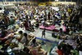 Filipinos take shelter inside a gymnasium in Mambaling village, Cebu province, some of the 600,000 who fled to safety as Typhoon Hagupit started battering the eastern Philippines yesterday. Photo: EPA