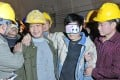 A worker (with eyes covered) is supported by his colleagues after being rescued from a collapsed expressway tunnel in Longyan city, Fujian province. Photo: Xinhua