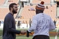 Indianapolis Colts quarterback Andrew Luck, left, talks with Cleveland Browns cornerback Johnson Bademosi. Photo: AP