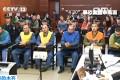State television broadcast defendants listen to verdict. Photo: Screenshot via CCTV