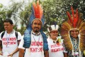 Marcio Kokoj (second left) and other members of the Coordination of the Indigenous Organizations of the Brazilian Amazon (COIAB), take part in a protest demanding commitments to curb global warming and the respect of indigenous territories, in Lima on December 8, 2014. Photo: Reuters