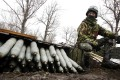 A Ukrainian artilleryman sits near shells at their position near the eastern Ukrainian village Pisky, Donetsk at Donetsk airport. Photo: AFP