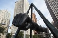 A sculpture in honor of heavyweight champion Joe Louis sits at the intersection of Woodward and Jefferson Avenue in downtown Detroit. Photo: Reuters