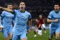 Manchester City's Samir Nasri celebrates his goal against Roma. Photo: EPA