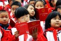 Students in Chongqing get acquainted with the Chinese constitution. Photo: AFP