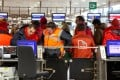 Union workers block a check-in counter at Zaventem airport in Brussels. Photo: AP