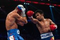 Manny Pacquiao takes apart previously unbeaten Chris Algieri in their World Boxing Organisation welterweight title bout in Macau on November 23. Photo: AFP