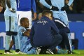 Vincent Kompany is assessed by medical staff after straining a hamstring during Manchester City's 1-0 win over Leicester City. Photo: Reuters