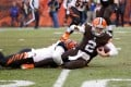 Cleveland's rookie quarterback Johnny Manziel is taken down by Cincinnati Bengals' Chris Carter during their NFL game. Photo: AFP