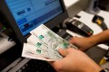 The rouble has fallen close to 20 per cent this week, taking its losses against the dollar this year to more than 50 per cent. Photo: Bloomberg