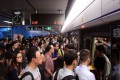 Some MTR commuters had to wait five minutes to enter stations this morning. Photo: Jonathan Wong