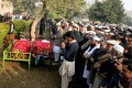 Mourners attend a funeral ceremony of two victims of the Taliban's attack on an army-run school in Peshawar. Photo: Xinhua