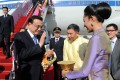 Premier Li Keqiang (left) is greeted upon arrival in Bangkok yesterday on a trip to attend the Greater Mekong Subregion Summit. Leaders from Myanmar, Cambodia and Laos will also attend. Photo: Xinhua